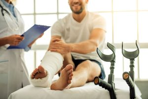 Oakville Physiotherapy Stages of Healing man with broken ankle and cast