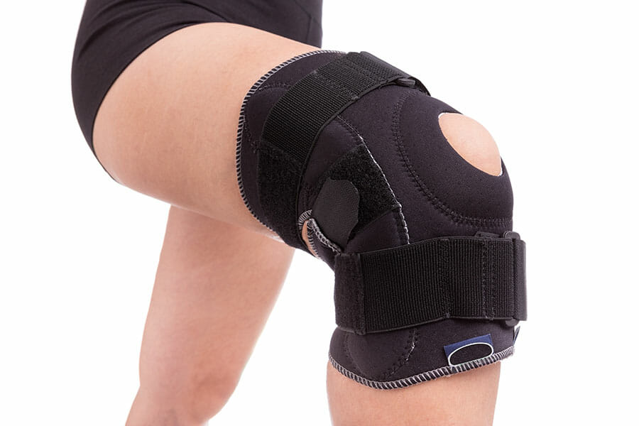 Woman in supportive leg brace physiotherapy oakville
