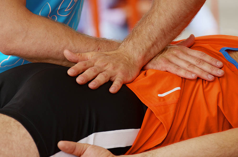 our sports phsyiotherapist helping a patient with low back pain in oakville
