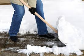 physiotherapy oakville how to shovel snow without pain, picture of a person shoveling heavey snow