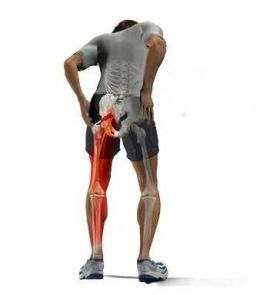 pinched nerve pain or sciatica running down the persons left leg, they are standing but hunched over, something our chirorpactor in oakville can fix