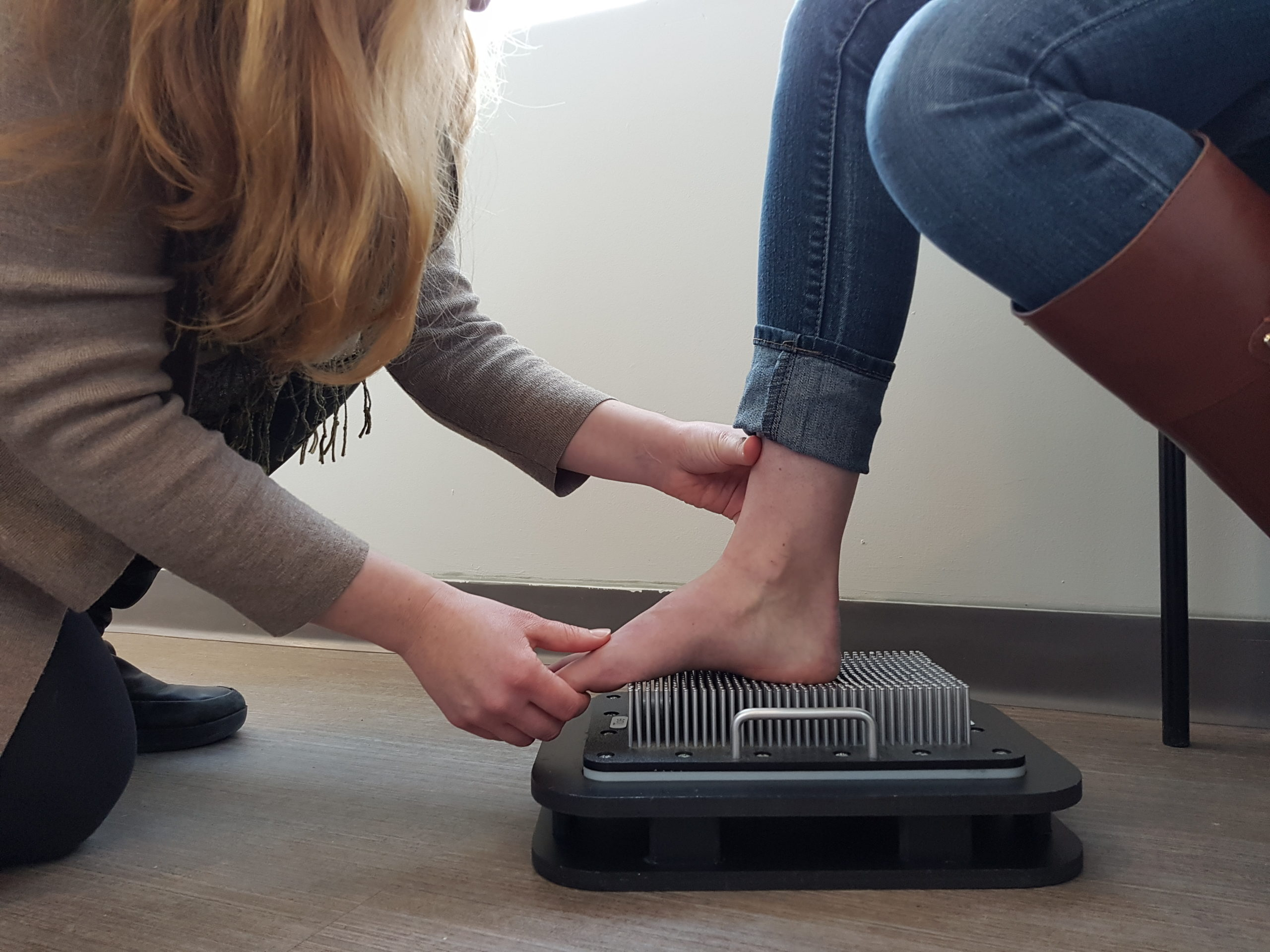 Oakville orthotics digital pin machine foot being pressed into pins
